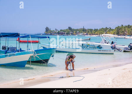 Small boats tied up in West Bay Roatan Honduras. - Stock Image
