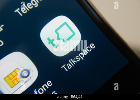 Image of the Talkspace app on a smartphone, button - Stock Image