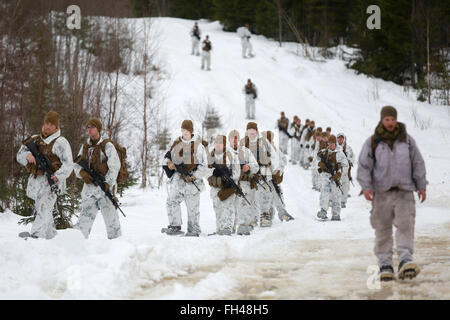 U.S. Marines assigned to The Combined Arms Company out of Bulgaria finish a patrol somewhere in the vast training - Stock Image