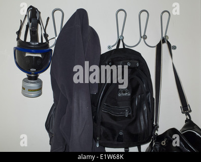 A gas mask hanging on a coat hook in a private house in Istanbul Turkey - Stock Image