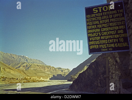 Notice at entrance to Upper Mustang restricted area and Kali Gandaki valley from Kagbeni on Annapurna circuit Himalayas - Stock Image
