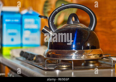 A Whistling Kettle Stands On A Switched Off Gas Stove. - Stock Image