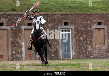 A Knight in full Armour demonstrating his Horse riding skills, during an  English Heritage Jousting Tournament at Dover Castle,  August 201 - Stock Image