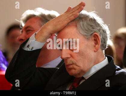 Former prime minister Gordon Brown gestures ahead of speaking at a campaign rally for the European Elections at the Lighthouse in Glasgow. - Stock Image