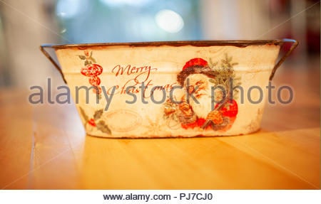 Vintage tin bowl with father Christmas and the text Merry Christmas - Stock Image