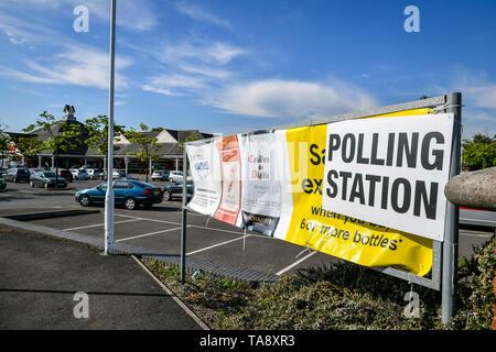A polling station sign in a supermarket car park in Bristol as voters head to the polls for the European Parliament election. - Stock Image