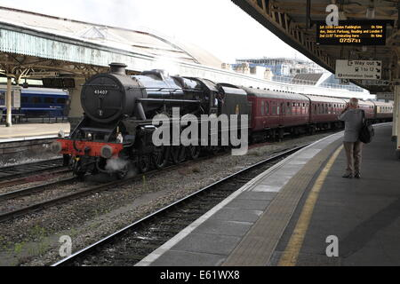 old train spotter photographing a steam locomotive at the head of a steam special at Temple Meads railway station. - Stock Image