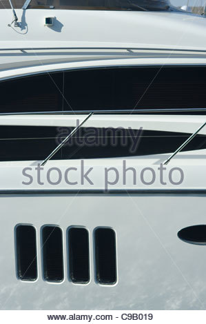 Windows on a large expensive private luxury motor cruiser yacht yachts millionaire wealthy wealth rich success - Stock Image