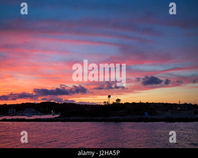 Oak Bluffs, MA, 2 September 2016: Weather phenomenon: An intense pink red orange and purple sunset in Oak Bluffs, - Stock Image