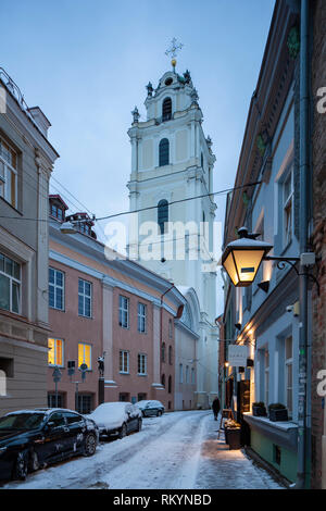 Winter evening at St John's church in Vilnius old town. - Stock Image