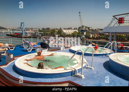 Portugal, Porto, Matosinhos, Leixoes Harbour, MV Marco Polo, passengers in jacuzzis of MV Marco Polo in sunshine - Stock Image