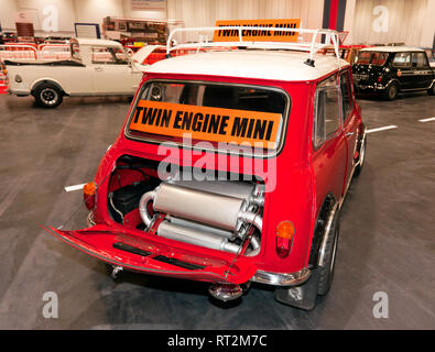 Rear view of a 1965, Twin-engine, Austin Mini Cooper S, on display at the 2019 London Classic Car Show. Showing the exhaust system in the boot. - Stock Image