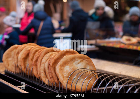 Langos for sale in the Christmas Market - Stock Image