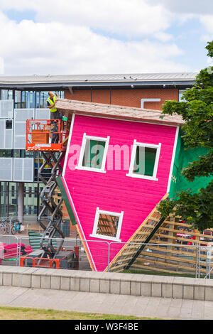 Dismantling of the Upside Down, topsy turvy, house at The Triangle, Bournemouth, Dorset UK in July - Stock Image
