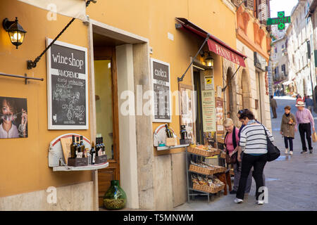 Montepulciano town centre, wine shop and bakery in one of the narrow hilly streets,Montepulciano,Tuscany,Italy - Stock Image