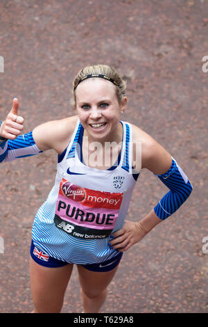 London, UK. 28th April 2019. Charlotte Purdue finishes The 39th London Marathon.Credit: Keith Larby/Alamy Live News - Stock Image