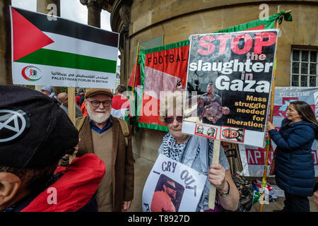 London, UK. 11th May 2019. People prepare to march from the BBC to a rally in Whitehall a few days before Nakba day showing solidarity with the Palestinian people and opposing continued Israel violation of international law and human rights. The protest called for an end to Israeli oppression and the siege of Gaza and for a just peace that recognises Palestinian rights including the right of return. It urged everyone to boycott and divest from Israel and donate to medical aid for Palestine. Peter Marshall/Alamy Live News Credit: Peter Marshall/Alamy Live News - Stock Image