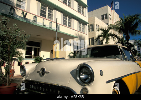 Miami Florida FL South Beach Art Deco 1950s white and yellow Chevrolet in front of Avalon - Stock Image