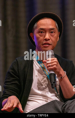 Bonn, Germany - June 8 2019: Ken Leung (*1970, American actor - Star Wars, LOST) talks about his experiences in the movie industry at FedCon 28 - Stock Image