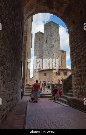 View on the Salvucci Towers, near Piazza del Duomo, San Gimignano, Tuscany, Italy - Stock Image