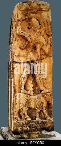 6427. HITTITE STORM GOD ADAD, STANDING ON A BULL AND HOLDING IN HIS HANDS PRONGS REPRESENTING LIGHTNING - Stock Image