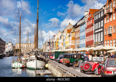 23 September 2018: Copenhagen, Denmark - Classic cars on display beside the canal in the Copenhagen district of Nyhavn, with its colourful 17th and 18 - Stock Image