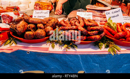 Typical cured Portuguese sausages known as Alheira hanging at a market stall in Portugal. - Stock Image