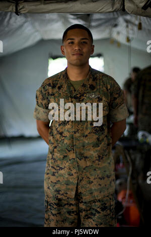 U.S. Navy Petty Officer 1st Class Michael Soto, a corpsman with 1st Medical Battalion, 1st Marine Logistics Group, poses for a photo during the Humanitarian Assistance Disaster Relief Village demonstration in Los Angeles, Calif., Aug. 28, 2018. The event included static displays from the U.S. Marines, City of Los Angeles public safety agencies, Los Angeles County Office of Emergency Management and several non-profit partners. I MEF provides the Marine Corps a globally responsive, expeditionary, and fully scalable Marine Air-Ground Task Force (MAGTF), capable of generating, deploying, and emplo - Stock Image