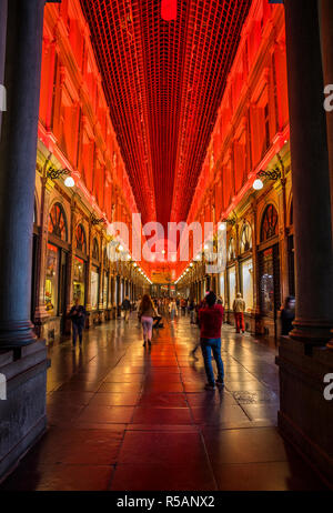 Red illimunated Royal Galleries of St Hubert in Bruxelles - Stock Image