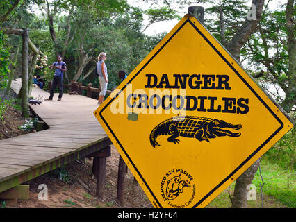 Warning sign at iSimangaliso Wetland park ,St Lucia,  home to possibly the largest population of Nile Crocodiles - Stock Image