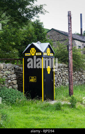 Automobile Association (AA) roadside emergency telephone box, situated near Dunmail Raise on the A591, north of Grasmere, Cumbria. The AA telephone bo - Stock Image