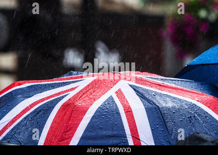 Union Jack Umbrella in the rain in London - Stock Image