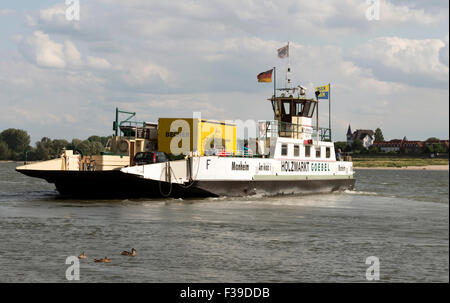 Monheim to Cologne-Langel passenger and car ferry on the river Rhine Germany, Hitdorf, Germany. - Stock Image