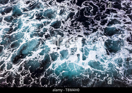 Foamy waves set off by a passenger ferry crossing the Gibraltar Strait betwen Tanger, Morocco and Algeciras, Spain. - Stock Image