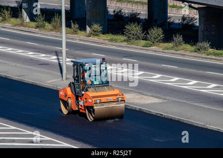 repair of the asphalt road, the machine puts a new coating on the road. Ukraine. Kiev 06.11.2018 - Stock Image