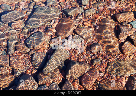 Submerged rocks beneath the flickering surface of Lake Superior, North Shore Minnesota. - Stock Image