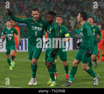 Beijing, China. 24th Apr, 2019. R. Augusto (1st L) of Beijing Guoan FC celebrates scoring during the group G match between China's Beijing Guoan FC and Thailand's Buriram United at the 2019 AFC Champions League in Beijing, capital of China, April 24, 2019. Credit: Ding Xu/Xinhua/Alamy Live News - Stock Image