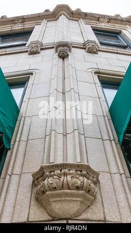 ASHEVILLE, NC, USA-1/18/19: A narrow vertical shot of a Tudor Revival/Late Gothic Revival concrete faux column on the face of the Grove Arcade. - Stock Image