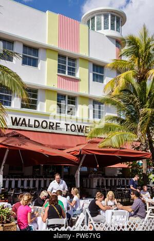 Miami Beach Florida Ocean Drive New Year's Day Art Deco District Waldorf Tower restaurant alfresco al fresco dining diners wai - Stock Image