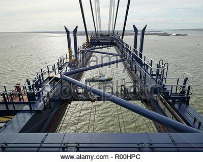 Dock crane above sea - Stock Image