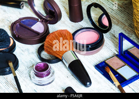 Putting on make up before going out - Stock Image