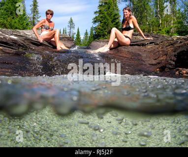 Two women sunbathing - Stock Image