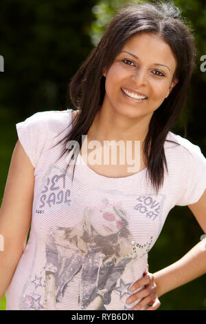 Portrait of attractive ethnic girl - Stock Image
