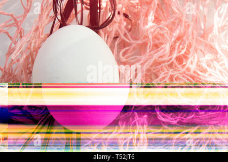 Shooting Easter, one egg on a pink background - damaged file. Abstract texture background noise Glitch camera VHS pixel error. For use in the modern f - Stock Image