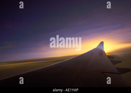 An aerial view from an airplane window near the wing. - Stock Image