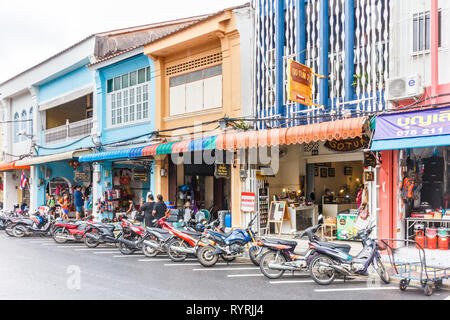 Phuket, Thailand - 11th April 2017: Motorcycles parked outside shops on Thalang Road. This is one of the main streets in the old town. - Stock Image