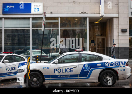 MONTREAL, CANADA - NOVEMBER 5, 2018: Two Montreal Police Service (SPVM) cars standing in front of a local police station. The SPVM is the municipal Mo - Stock Image