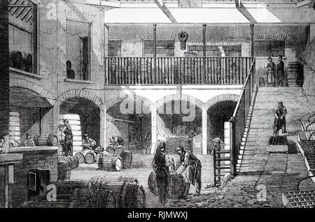 An engraving depicting England's wine trade: Gilbey's wine stores, 1875 - Stock Image