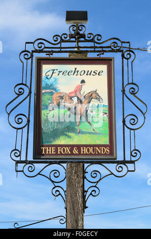 The pub sign of The Fox and Hounds Pub, Uffington, Oxfordshire, England, UK. - Stock Image