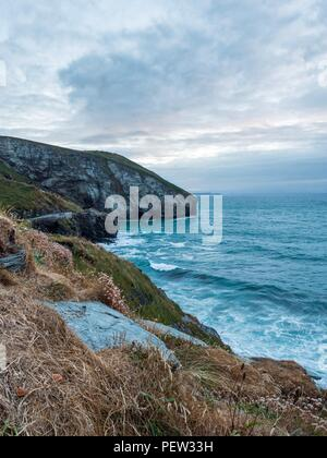 Looking down at the waves crashing on the coast in Trebarwith Strand, Cornwall - Stock Image